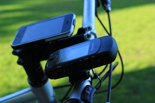 Garmin gps next to the iPhone on bicycle handlebars