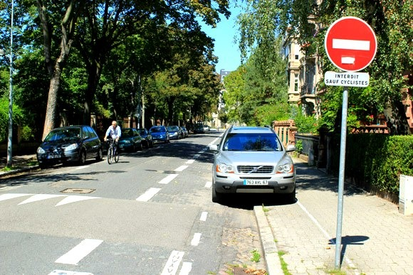 Another road where bicycles are permitted to travel in both directions and cars are not