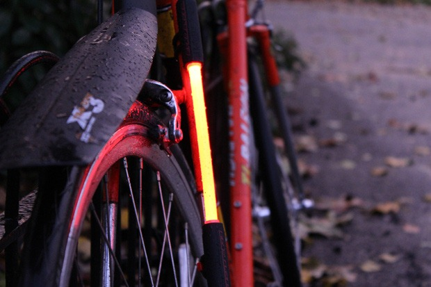 Red Fibre flare shown on the rear of a rain drop covered bike