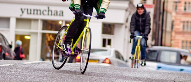 Cyclists riding past Yumchaa in London