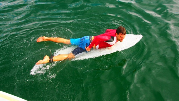 Sean on his surf board
