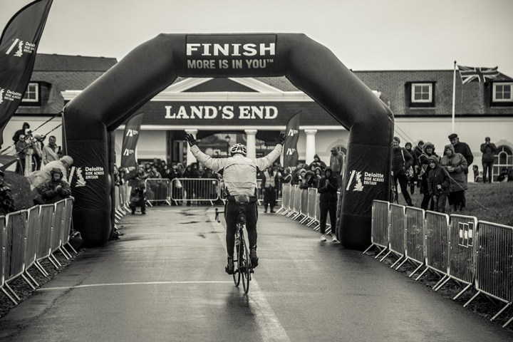 Cyclist rides across the finish line