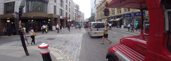 Pedestrian walking out infront of a bus