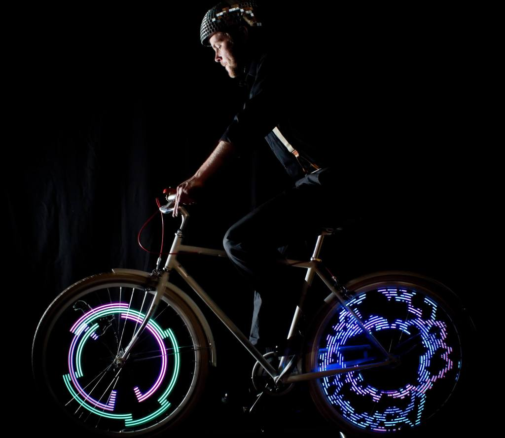 Man on bike with MonkeyLectric wheel lights