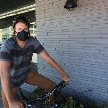 Man on his bike with cycling mask