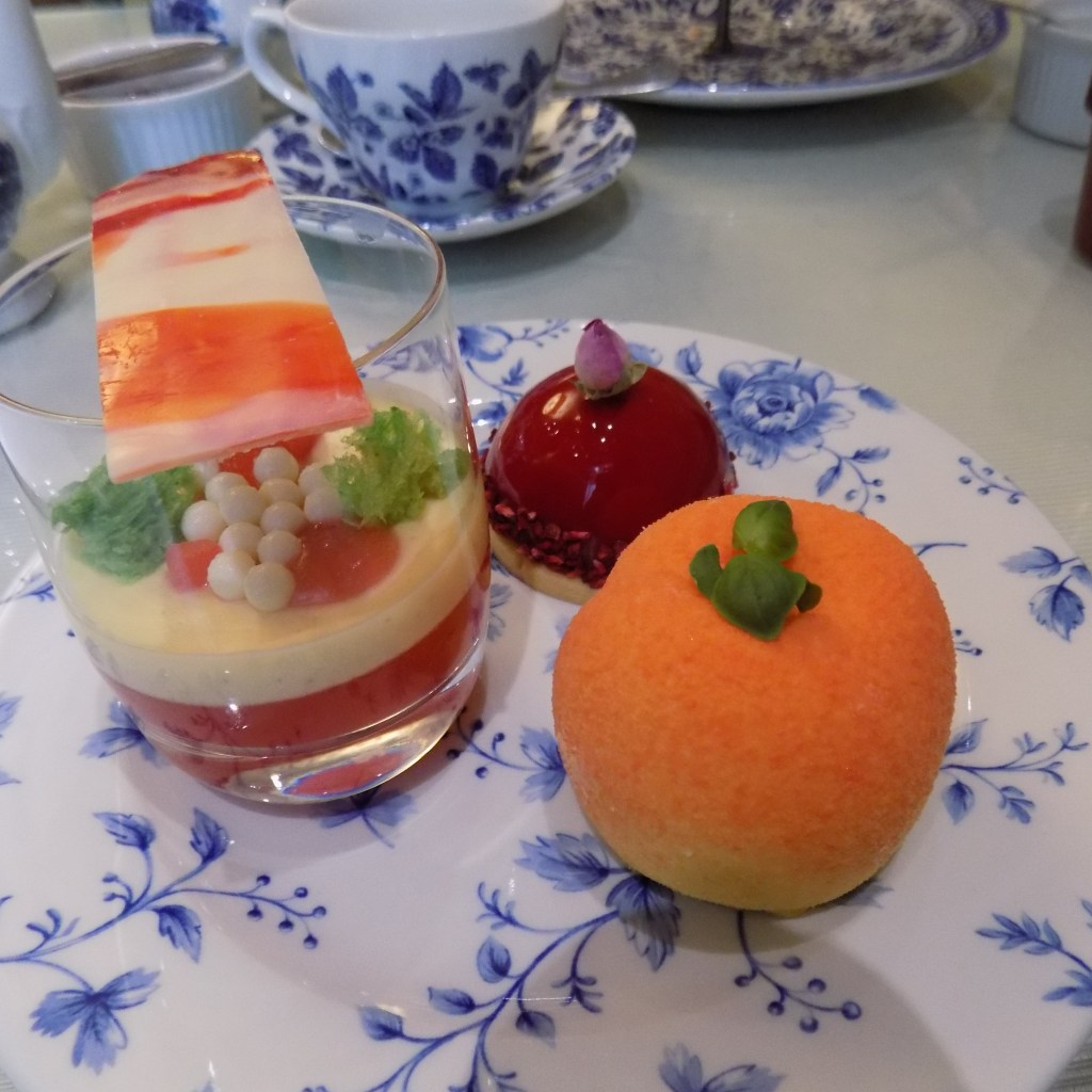 The cakes, rhubarb and custard verrine, raspberrry, rose and vanilla sable and peach and apricot mousse