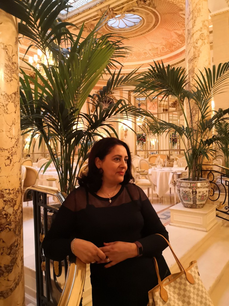 In front of the Palm Court where Afternoon Tea is served.