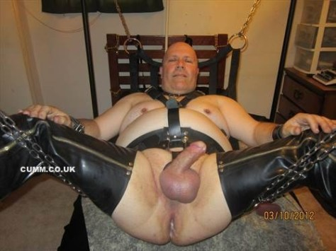over-leather-dad-in-sling-erection