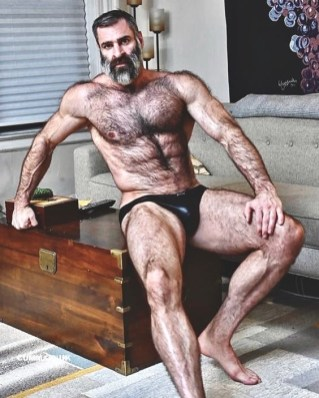bearded french guy in budgie smugglers
