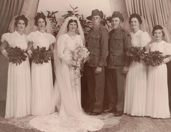Evelyn Randell and Cecil Hannaford wedding, studio portrait with their wedding party. Married on 31 May 1941