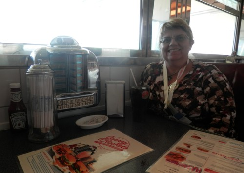 Helen at Johnny Rockets waiting for her burger