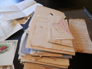 the pile of old letters in the tin