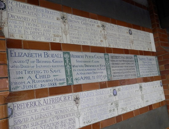 a few of the plaques on the memorial wall at Postman's Park
