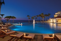 Dreams Los Cabos Suites Golf Resort & Spa - Activities - A nighttime view of the infinity pool facing the Sea of Cortez