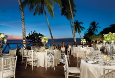 Dreams La Romana Resort & Spa - Weddings - The exquisite group dinner set-up at Dreams La Romana offers stunning views of the Caribbean and sandy-white beaches