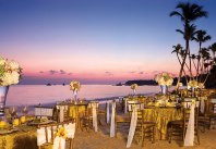 Dreams Palm Beach Punta Cana - Weddings - A dinner set-up on the sandy-white beach at Dreams Palm Beach during a magnificent sunset