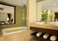 Dreams Palm Beach Punta Cana - Accommodations - The Deluxe Jacuzzi Preferred Club bathroom features lavish amenities, double sinks and a spacious Jacuzzi