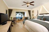 Dreams Palm Beach Punta Cana - Accommodations - The Preferred Club suite features a king bed, ceiling fan and a furnished balcony or patio with breathtaking views of the Caribbean