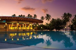 Dreams La Romana Resort & Spa - Activities - A shot of the infinity pool during an exquisite sunset with the Oceana Restaurant in the background
