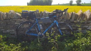 Bike in front of a stone wall.