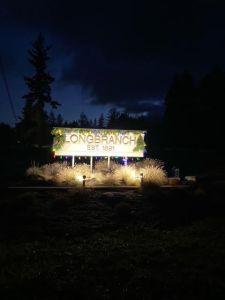 longbranch washington sign lit at night