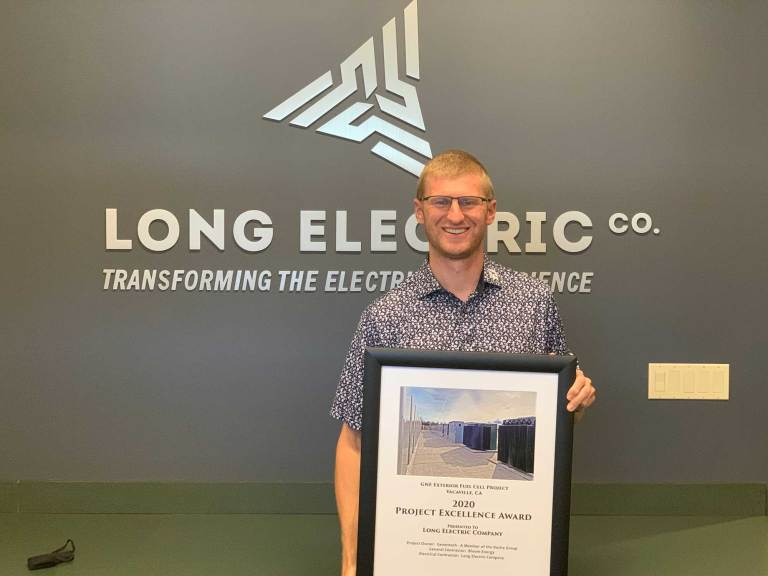 Jordan Long holds the award for the 2020 NorCal NECA Project Excellence for work on the GNE Fuel Cell project