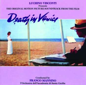 The album cover for Visconti's Death In Venice. The background is violet with indigo scrawled lettering spelling out the title. An image in the centre shows a woman wearing a white dress on a beach and a man looking on, writing something down.