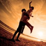 Posted by Looking Beyond Master Psychics - Happy and romantic scene of love with couple on the beach