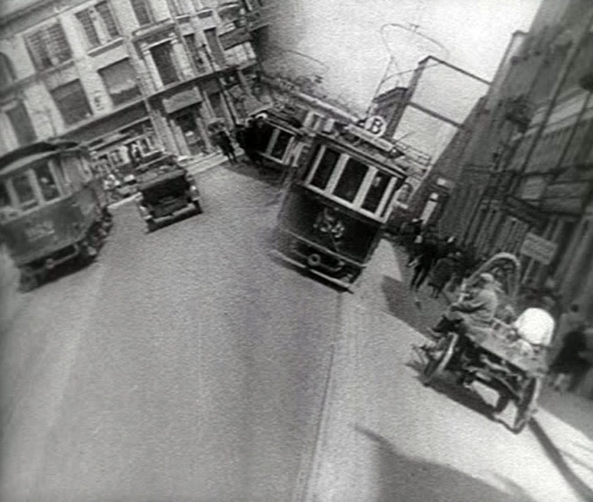 man with a movie camera - streetcar