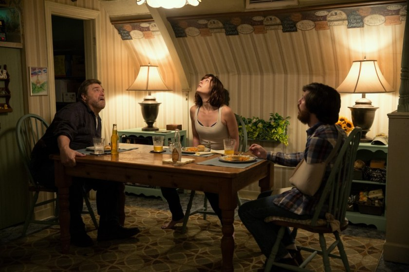 (L-R) John Goodman as Howard, Mary Elizabeth Winstead as Michelle, and John Gallagher Jr. as Emmett in 10 CLOVERFIELD LANE, by Paramount Pictures