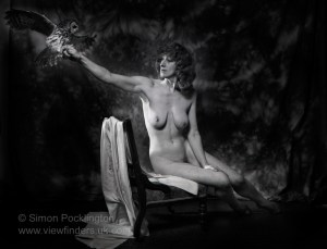 nude portrait of woman with owl