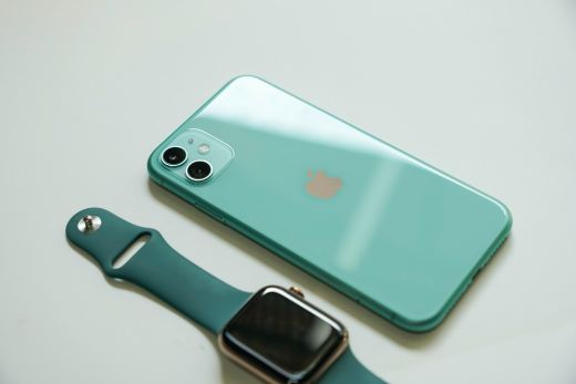 silver iphone 6 with blue sport band apple watch