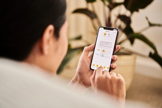 A woman looking at a contract on DocuSign from a iPhone
