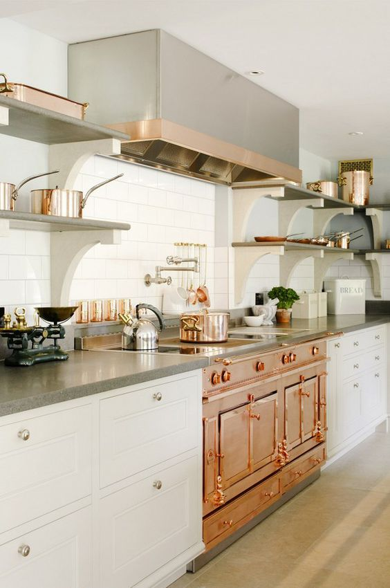 On trend neutral kitchen with copper elements in the middle