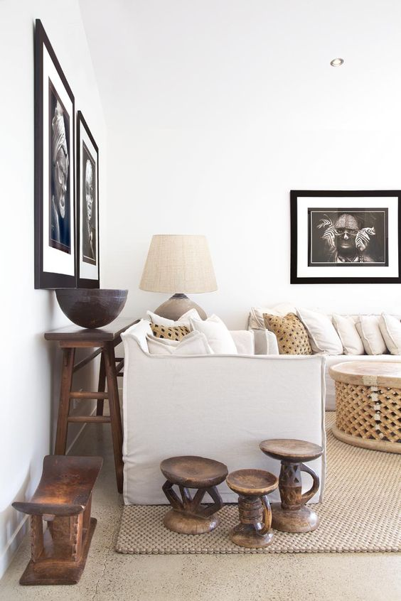 African art pieces and furniture makes this simple living room unique