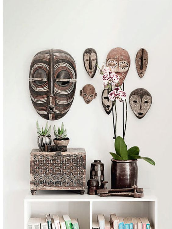 African masks as wall art gives this space stylish vibe