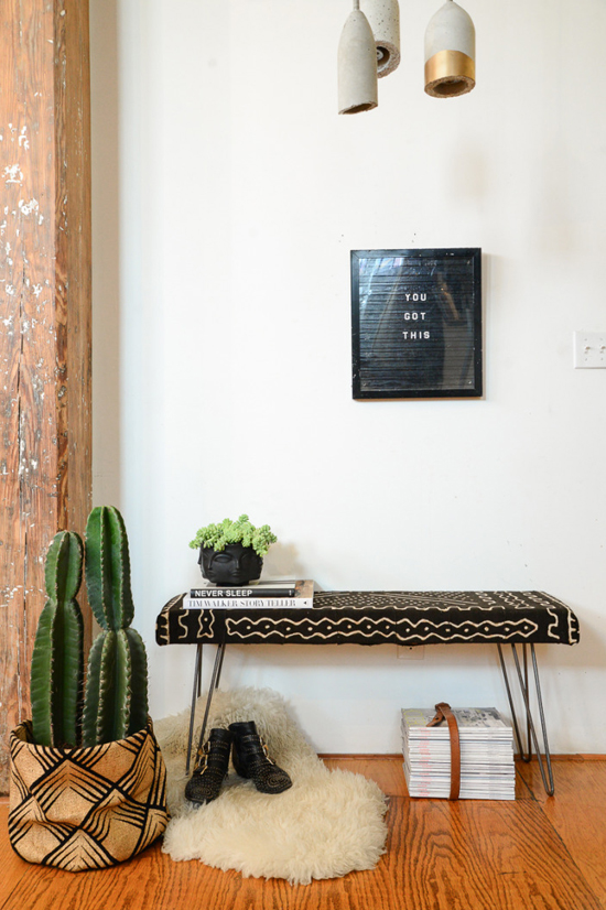 Chic entryway inspired by Africa with earth tones and mud cloth bench