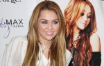 """Miley Cyrus CDs and DVD Signing and """"Miley and Max"""" Clothing Line Launch at ASDA in Derby on November 9, 2010"""