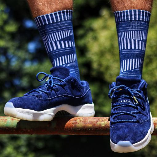 blue black rope shoelaces on suede blue jordans