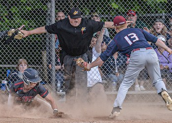 Independence's Michael McKinney, left, slides in safely to home as Bluefield pitcher Gavin Lail is late with the tag during Thursday action in Coal City. (F. Brian Ferguson/Lootpress)
