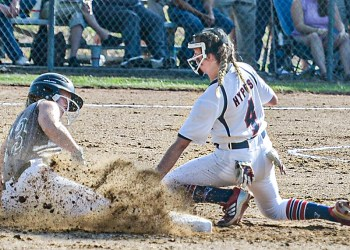 Wyoming East's Lilly Hill, left, slides safely into second as Independence shortstop Alli Hypes waits for the throw during Monday action in Coal City. (F. Brian Ferguson/Lootpress)