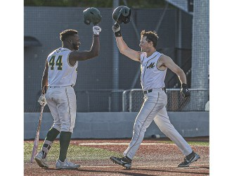 WV Miners Malik Williams, (left) taps helmets with Patrick Mills after Mills hit a towering home run during Tuesday evening action against Champion City. (F. Brian Ferguson/Lootpress)