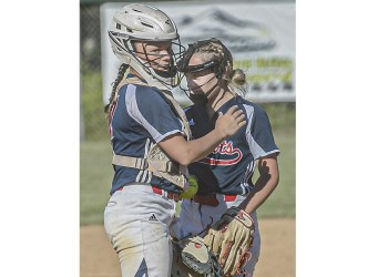 Independence catcher Kaylen Parks, left, talks with pitcher Delaney Buckland during Wednesday action in Coal City. (F. Brian Ferguson/Lootpress).
