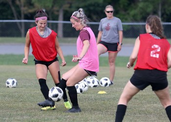 (Brad Davis/For LootPress) Woodrow Wilson senior Jennifer Bair, 2nd from left, works through drills with her teammates during practice Monday afternoon at the YMCA Paul Cline Memorial Soccer Complex.