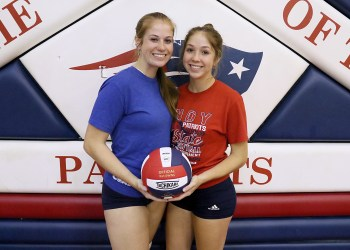 (Brad Davis/For Lootpress) Sisters Kyra, left, and Jaina Davis pose for a quick photo together before Independence volleyball practice August 18 in Coal City.