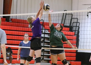 (Brad Davis/For LootPress) Greater Beckley Christian players Kate Lowe, left, and Shayla Martin contest a ball at the net during practice August 30 in Prosperity.