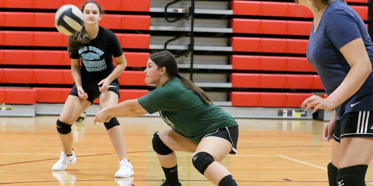 (Brad Davis/For LootPress) Greater Beckley Christian junior Shayla Martin returns a ball as she and teammates work through drills during practice August 30 in Prosperity.
