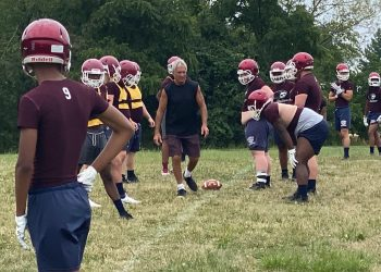 Bluefield head coach Fred Simon instructs his offensive line during a practice at Bluefield High School.