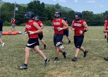 PikeView players exit the practice field for a water break during a Wednesday practice in Gardner.