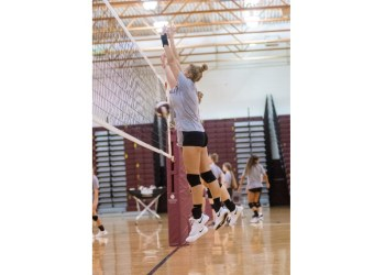 Beckley's Olivia Ziolkowski goes up for the block at the net during a practice at Woodrow Wilson High School. (Heather Belcher/Lootpress)